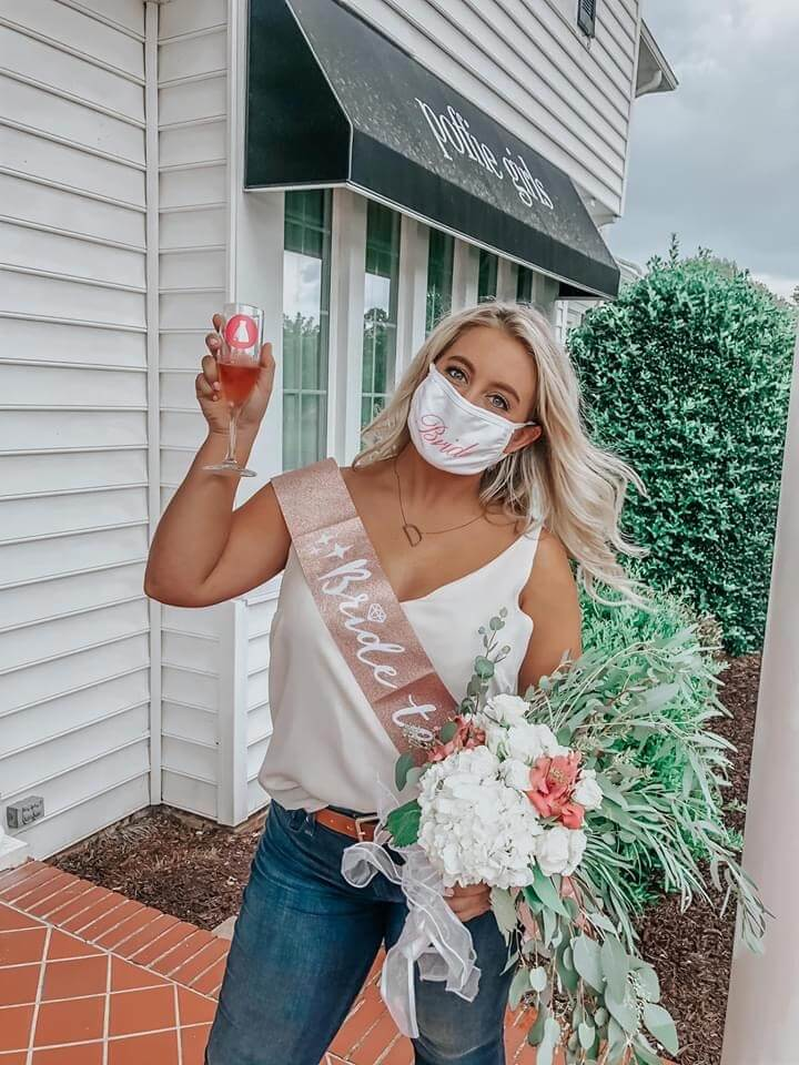 Woman with blonde hair posing outside of bridal boutique